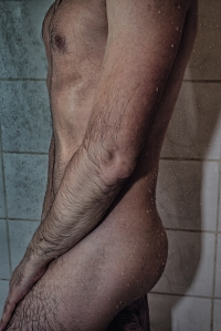 body of a young man in the shower